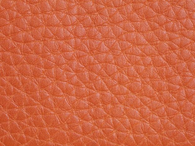 Fundo de textura de couro de gado laranja genuíno. foto macro
