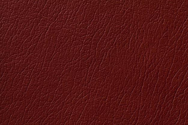 Fundo de textura de couro gengibre escuro com padrão, closeup
