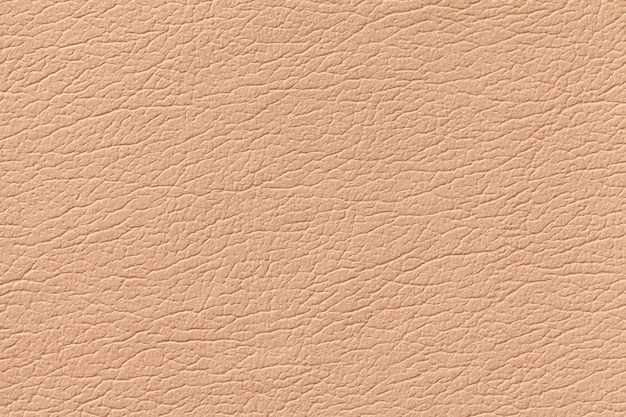 Fundo de textura de couro laranja claro com padrão, closeup