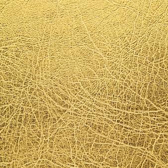 Fundo de textura de couro ouro em proporção quadrada