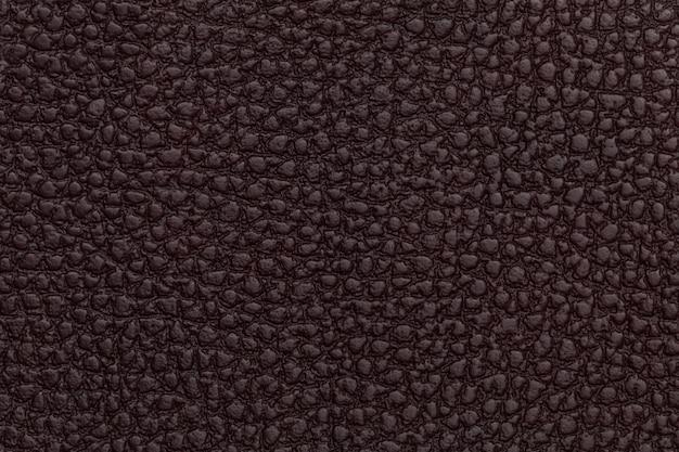 Fundo de textura de couro vermelho brilhante closeup foto