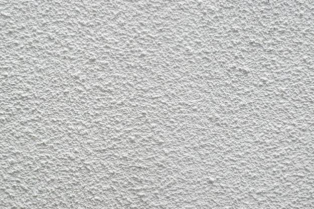 Fundo de textura de estuque branco de uma parede de pedra seca