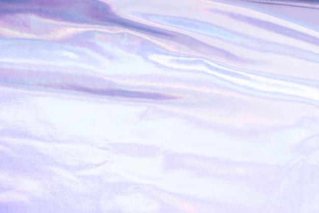 Fundo de textura de folha de sereia iridescente holográfica. cores prata na moda futurista néon