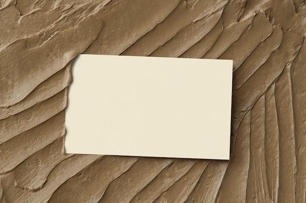Fundo de textura de glacê marrom com cartão de visita