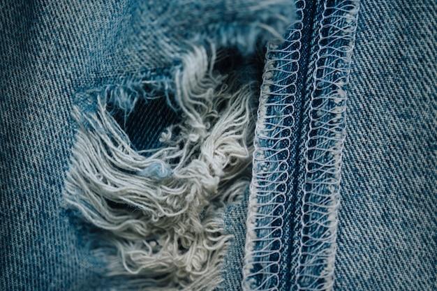 Fundo de textura de jeans desgastado com foco seletivo