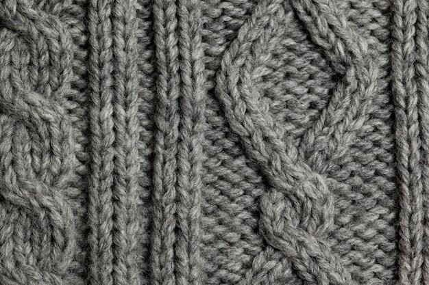 Fundo de textura de lã de tricô cinza feito à mão