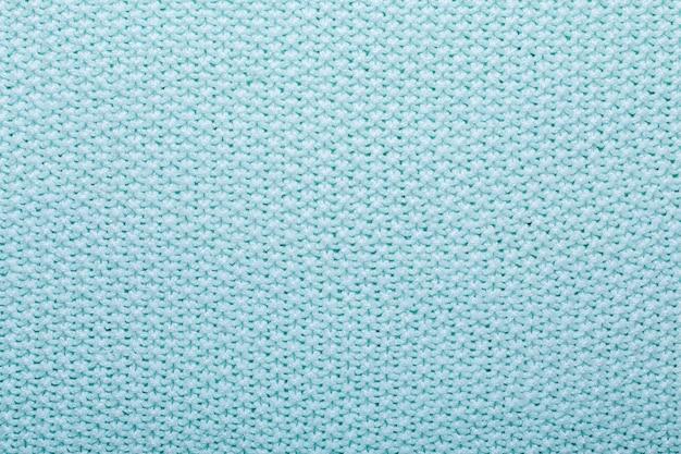 Fundo de textura de lã de tricô de hortelã textura de tecido de crochê vista superior espaço para texto