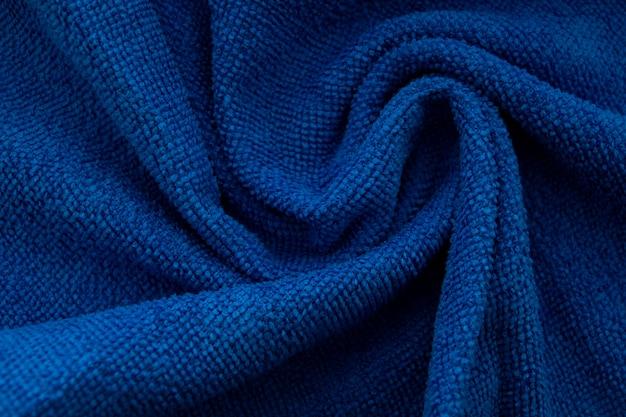 Fundo de textura de lã tricô artesanal. cor azul pantone clássica do ano 2020