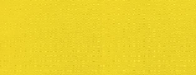 Fundo de textura de lona amarela. tecido limpo