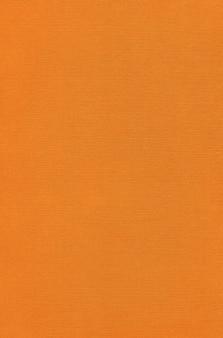 Fundo de textura de lona laranja. tecido limpo