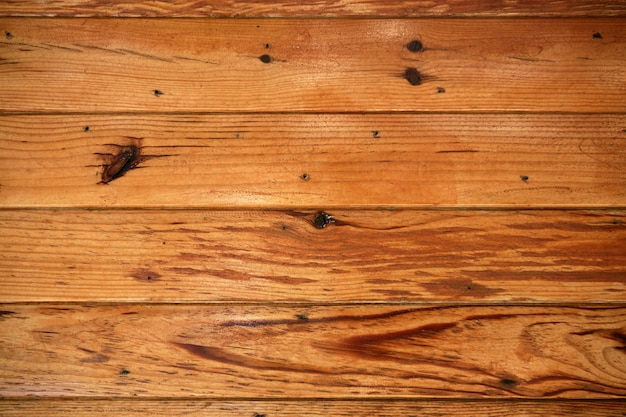 Fundo de textura de madeira laranja dourado