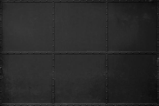 Fundo de textura de metal preto escuro. portas do armazém portas de ferro preto.