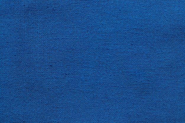 Fundo de textura de pano de tecido de algodão azul escuro, padrão sem emenda de têxteis naturais.