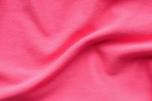 Fundo de textura de pano rosa abstrato