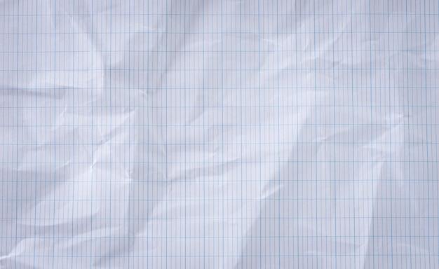 Fundo de textura de papel amassado branco de close-up.