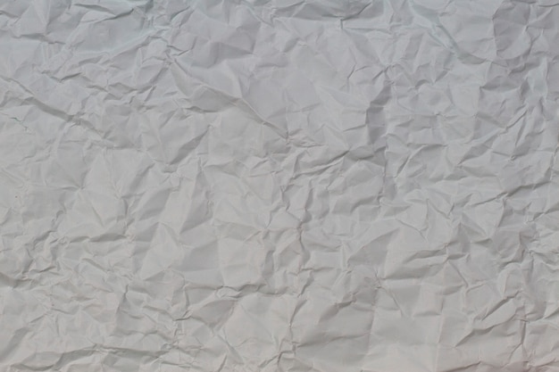 Fundo de textura de papel amassado cinza claro e enrugado