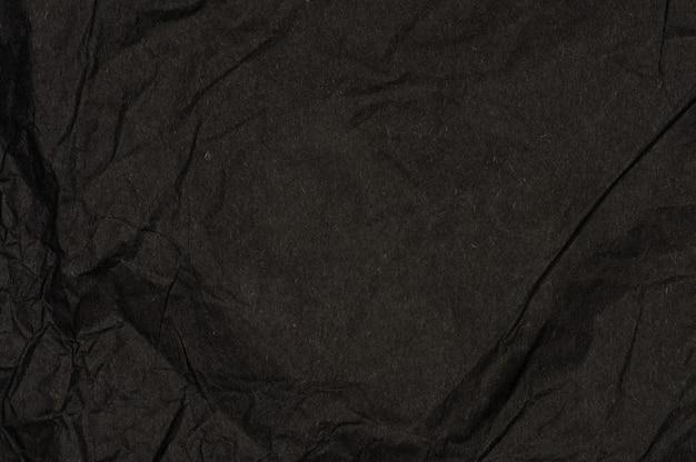 Fundo de textura de papel amassado preto. copie o espaço no design.
