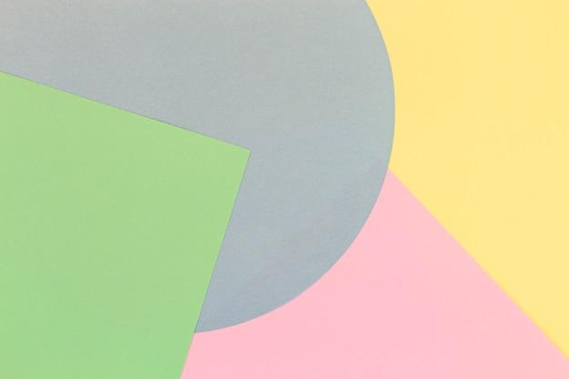 Fundo de textura de papel colorido abstrato com formas geométricas mínimas e linhas nas cores rosa pastel, azul, verde e amarelo