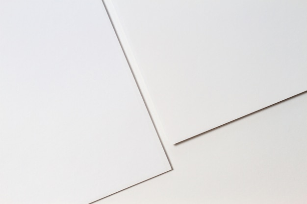 Fundo de textura de papel criativo monocromático branco abstrato. formas e linhas geométricas mínimas