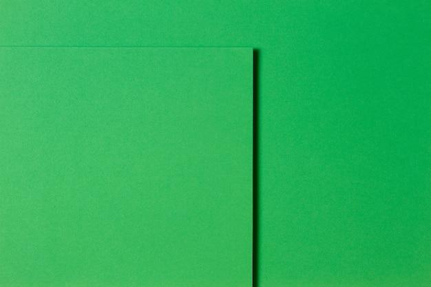 Fundo de textura de papel criativo monocromático verde abstrato. formas e linhas geométricas mínimas