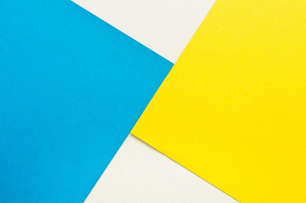 Fundo de textura de papel de cor azul e amarela brilhante.