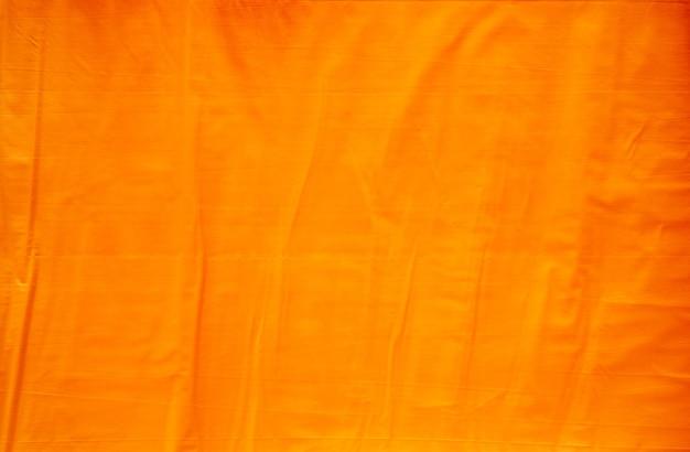 Fundo de textura de papel laranja com rugas abstratas