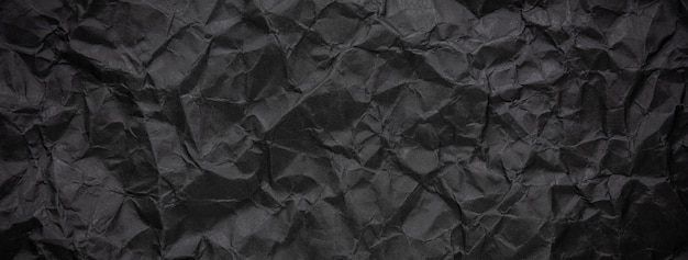 Fundo de textura de papel preto escuro amassado