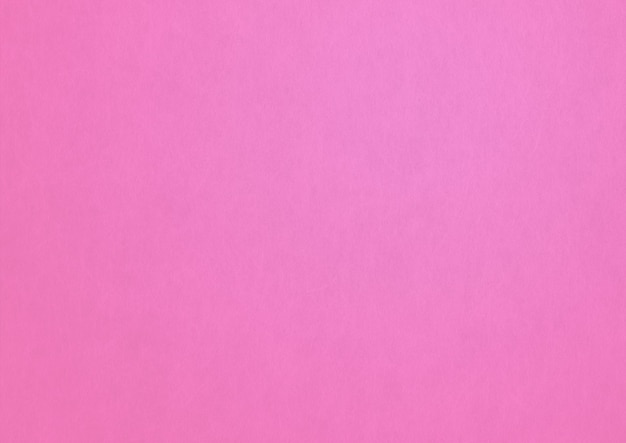 Fundo de textura de papel rosa pálido.
