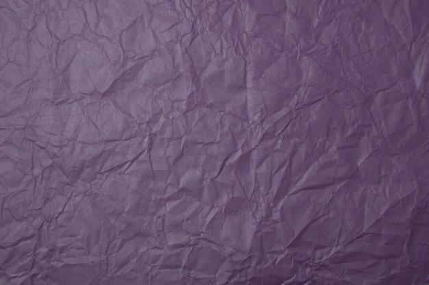 Fundo de textura de papel roxo amassado