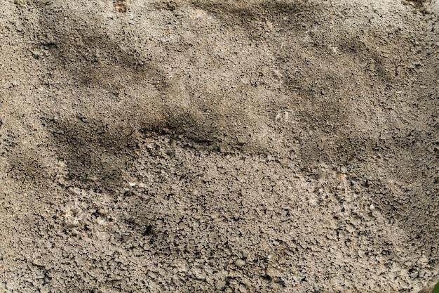 Fundo de textura de parede cinza montanhosa de concreto