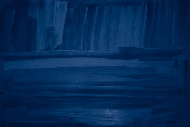 Fundo de textura de parede com pinceladas de tinta azul