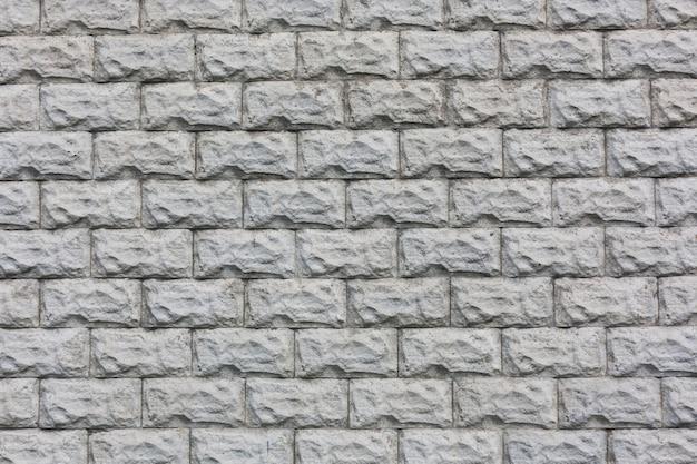 Fundo de textura de parede de azulejos de tijolos de pedra branca