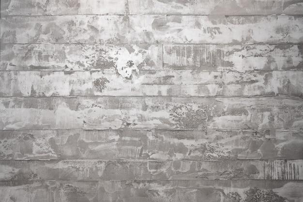 Fundo de textura de parede de concreto. estilo interior do loft, fundo do grunge. fragmento de parede de cimento com arranhões e rachaduras, estuque cinza decorativo abstrato.