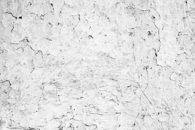 Fundo de textura de parede de concreto. fragmento de parede com arranhões e rachaduras