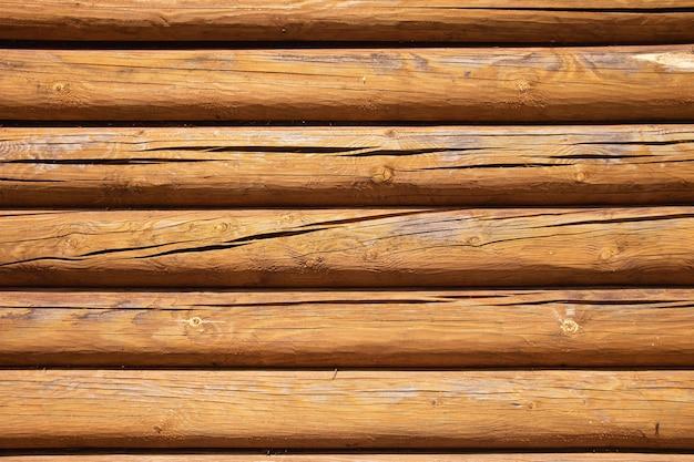 Fundo de textura de parede de registro de madeira. parede do close up da velha casa de madeira.