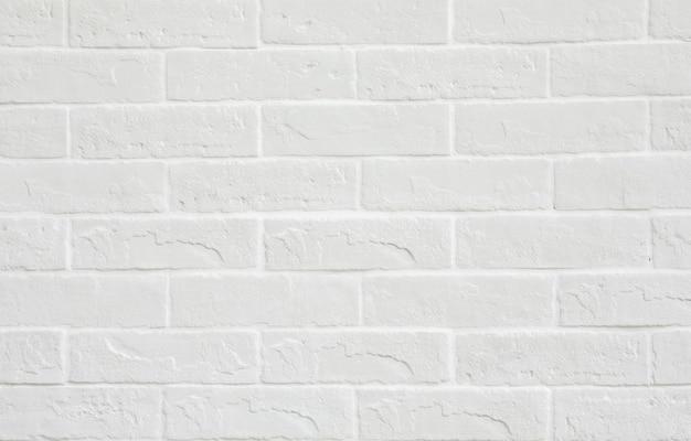 Fundo de textura de parede de tijolo branco.