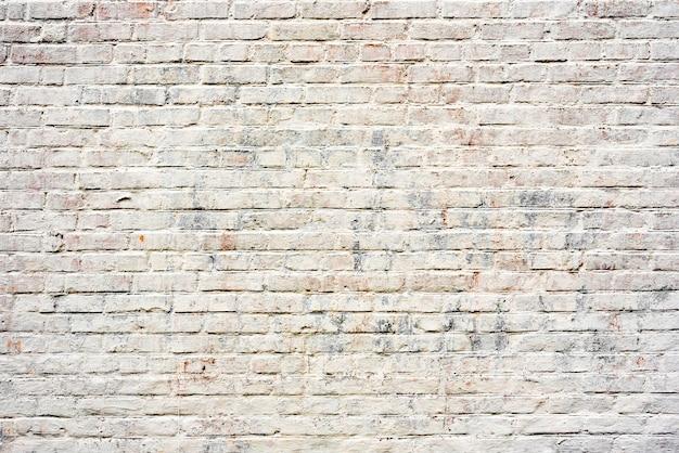 Fundo de textura de parede de tijolo. textura de tijolo com arranhões e rachaduras