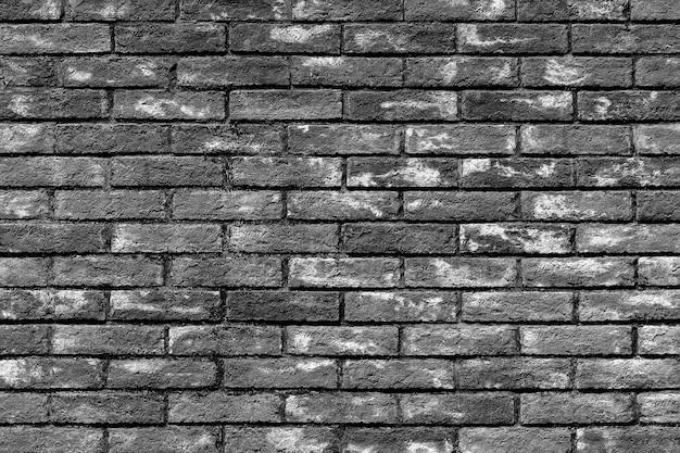 Fundo de textura de parede de tijolo vintage, preto e branco
