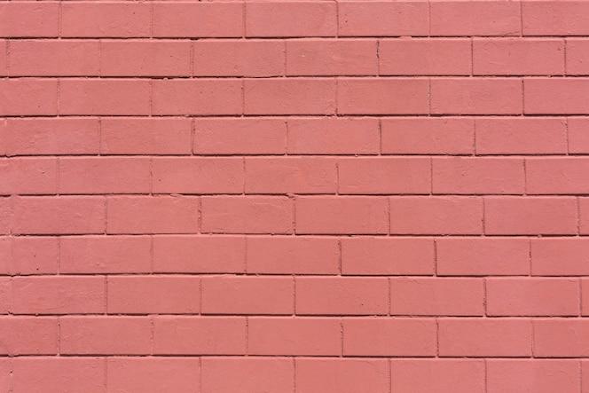 Fundo de textura de parede de tijolos de pedra horizontal pintado de vermelho