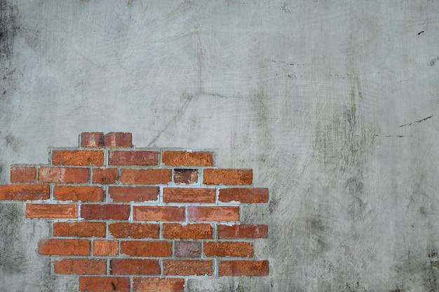 Fundo de textura de paredes de cimento e rachaduras de tijolos antigos na superfície da parede