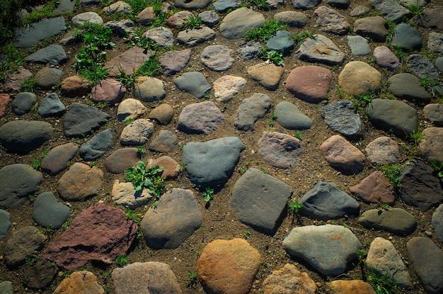 Fundo de textura de pavimento de rua apedrejado