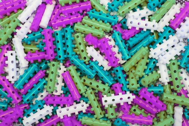 Fundo de textura de peças de grife infantil coloridas. foto macro