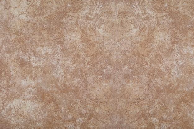 Fundo de textura de pedra em tons de marrons.