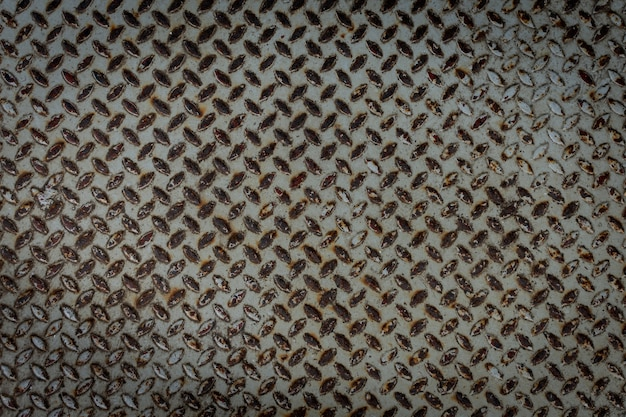 Fundo de textura de placa de aço com diamante enferrujado.