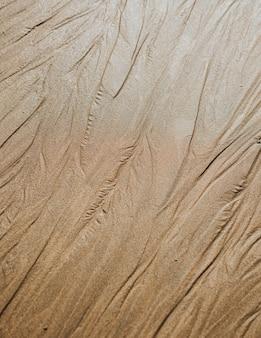 Fundo de textura de praia de areia bege