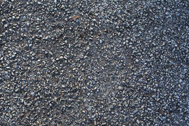 Fundo de textura de rocha. cimento de piso velho. padrão de asfalto