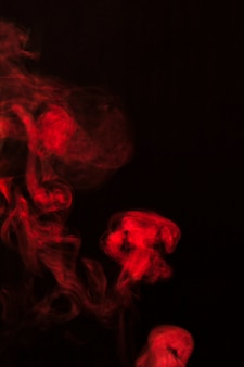 Fundo de textura de sobreposição de fumaça vermelha à deriva