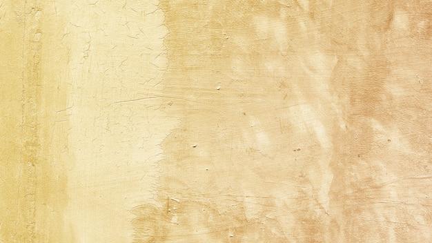 Fundo de textura de superfície pintada em amarelo metálico