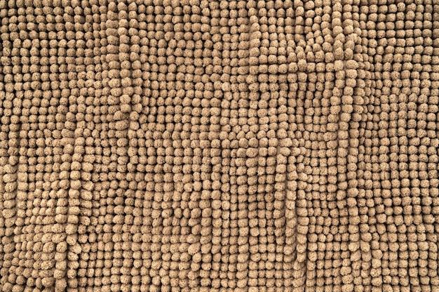 Fundo de textura de tapete de padrão de tecido marrom abstrato
