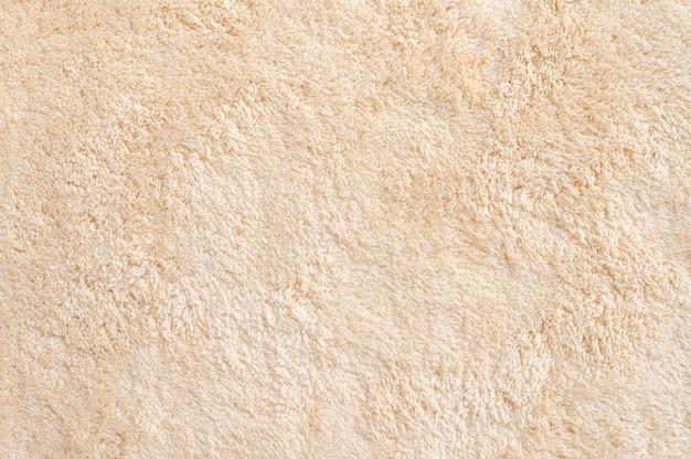 Fundo de textura de tapete de pelo marrom abstrato